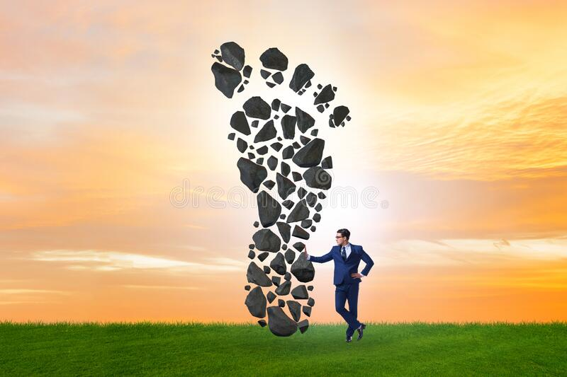 Carbon footprint concept with businessman stock photography