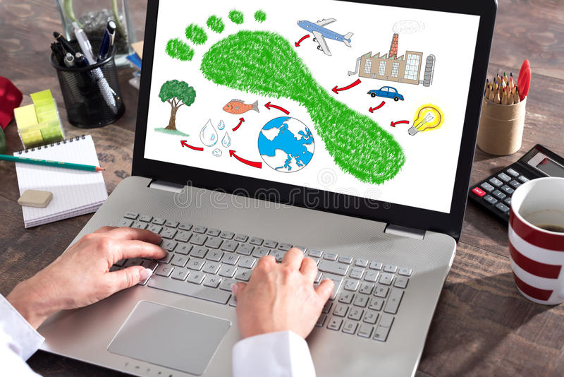 Carbon footprint concept on a laptop screen. Carbon footprint concept shown on a laptop screen royalty free stock photo