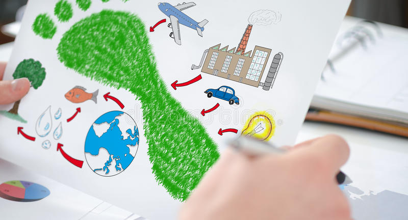Carbon footprint concept on a paper. Hands holding a paper showing a carbon footprint concept royalty free stock photo