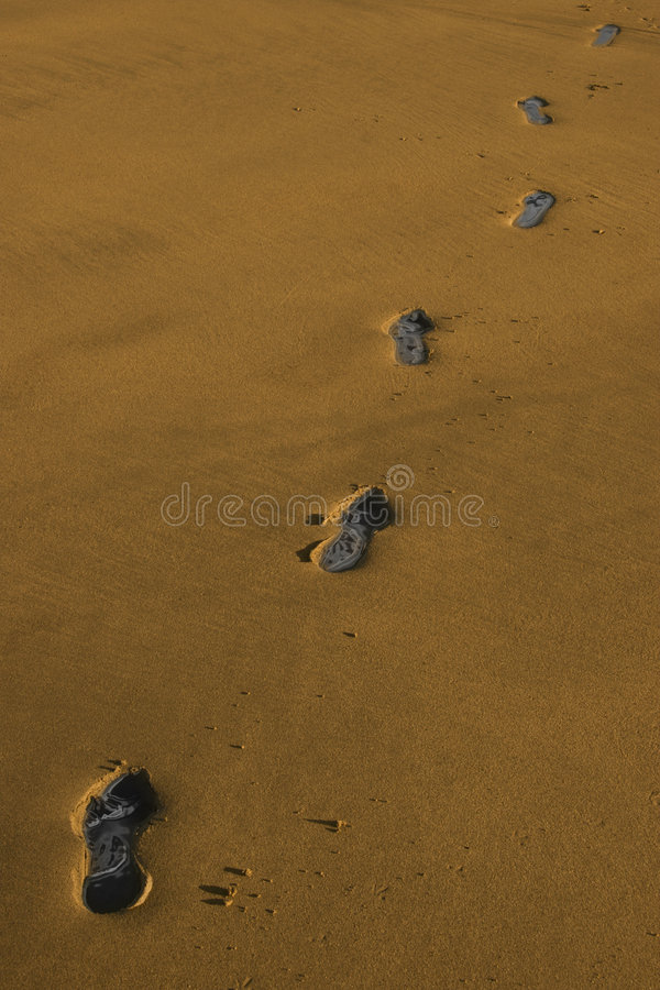 Carbon footprints 1. Carbon footprint tracks on a beach in ireland stock photography