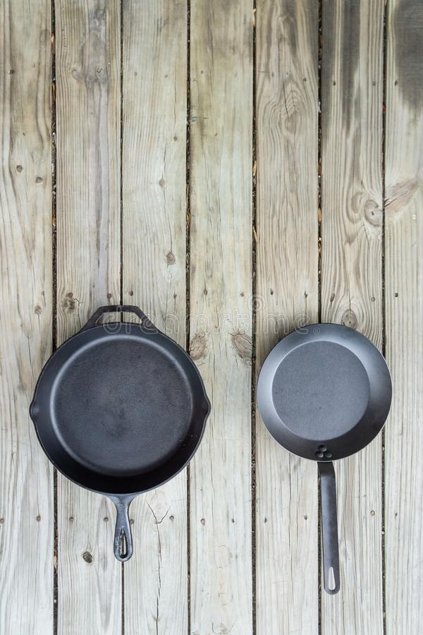 Carbon steel vs cast iron versus teflon pans and skillets - copy space on top stock photography