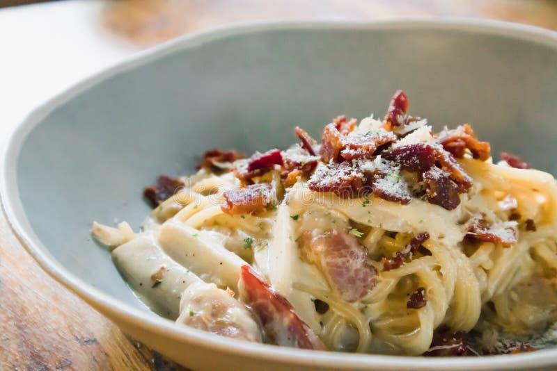 Carbonara pasta, spaghetti with ham, baecon, cheese and cream sauce stock photo