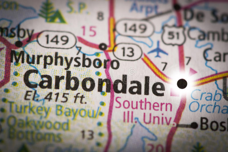 Carbondale, Illinois on map. Closeup of Carbondale, IL on a road map of the United States with the dot representing the city changed to look like a solar eclipse stock images