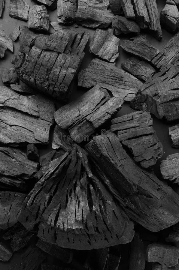 Carbonio su un fondo nero, toni neri su struttura nera immagini stock