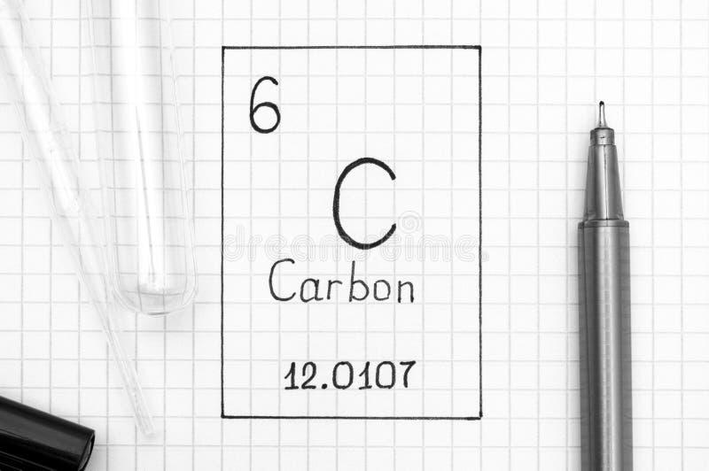 Carbono C do elemento químico da escrita com pena preta, tubo de ensaio imagens de stock royalty free