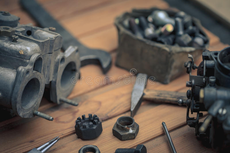 Carburetors for a car engine with tools stock photos