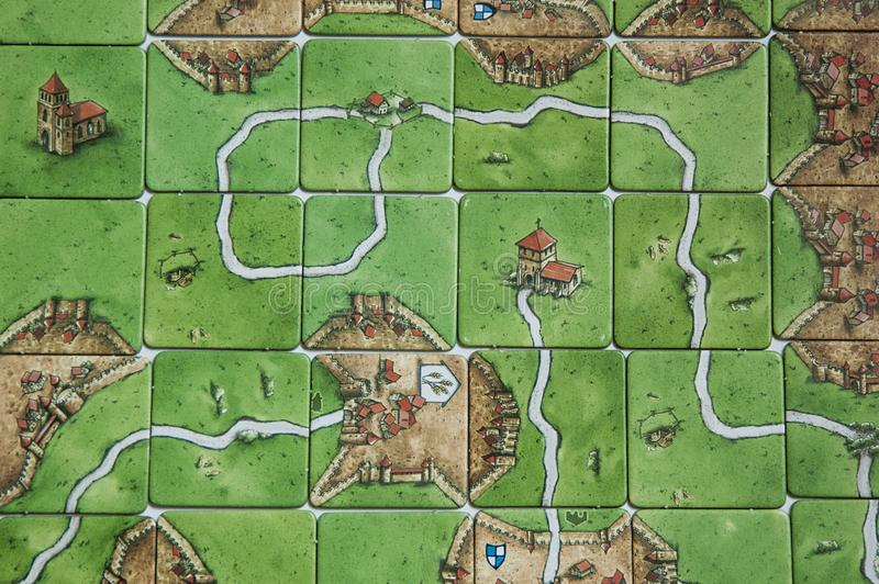Carcassonne board game background. Green field for players. stock photos