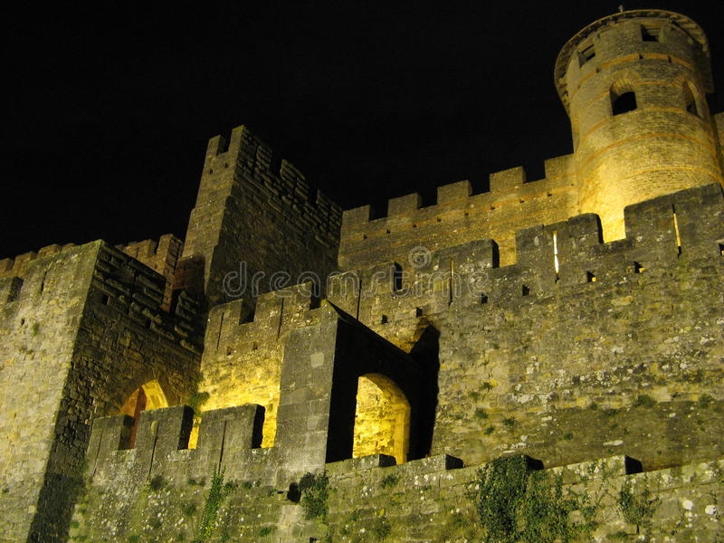 Carcassonne Castle. Also called La Cite, in France at night with colorful lighting stock images