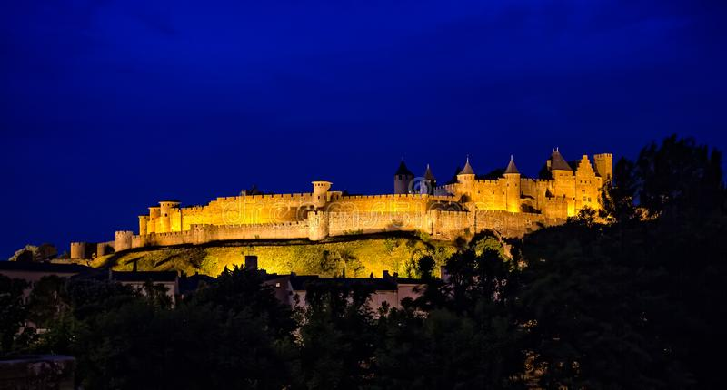 Carcassonne Castle at night in blue hour, taken in Carcassonne, Aude, France royalty free stock photo