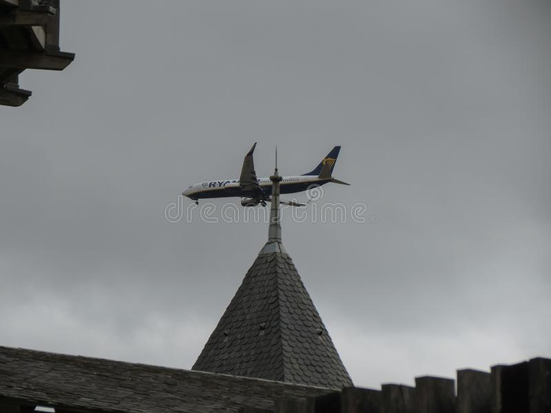 RyanAir Boeing 737-800 flying over Carcassonne. CARCASSONNE, FRANCE - CIRCA AUGUST 2018: RyanAir Boeing 737-800 flying over the medieval city of Carcassonne stock image