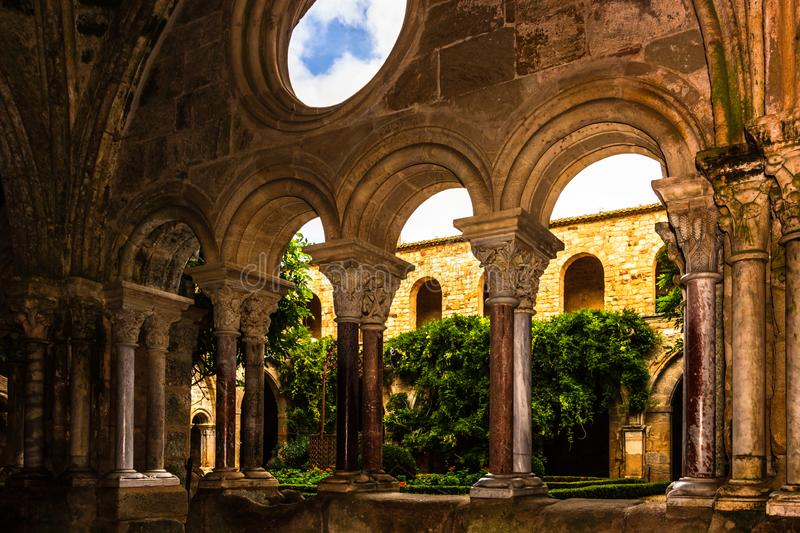 Carcassonne, France - 2019. Fontfroide Abbey monastery in France.Gothic walls and arches stock images