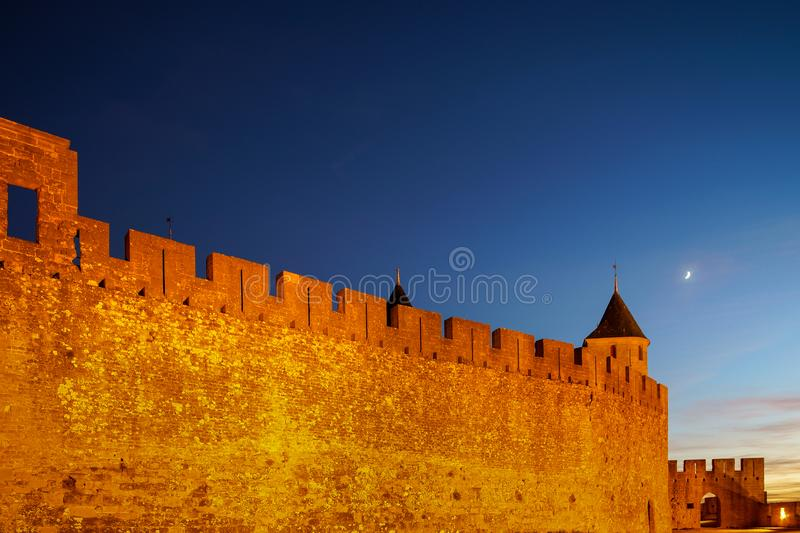 Carcassonne medieval fortress highlighted night view with moon i. N blue sky, France stock images