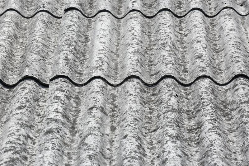 Carcinogenic asbestos tiles on a roof royalty free stock photos
