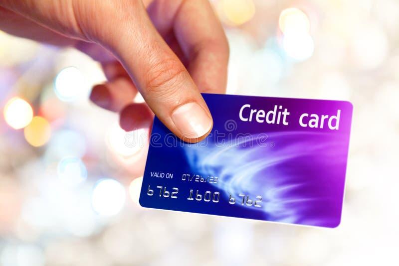 Card. Close-up of man hand holding plastik credit card stock photos