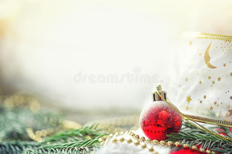Card with branches of spruce, christmas ball, beading, packing tape and copy. new year background. Card with branches of spruce, christmas ball, beading, packing stock photo