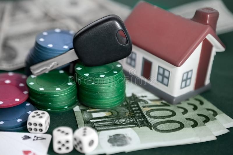 Card chips with car keys and house. Card chips with car keys, house, money, cards and cubes royalty free stock image