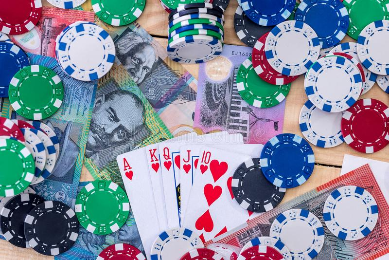 Card combination on australian dollars with casino chips . Card combination on australian dollars with casino chips stock image