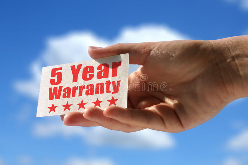 Card with five year warranty inscription stock images