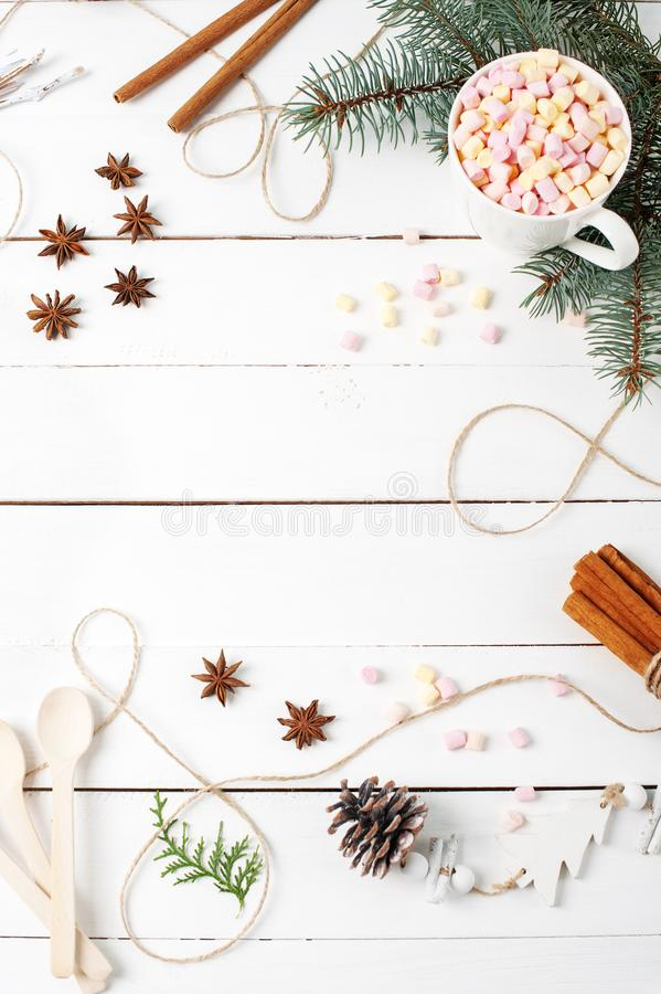 Card Frame composition of Cocoa, Marshmallow, Cinnamon, Anise Stars, Coffee Seeds, Fir Tree, Spoons Ingredients Stuff stock images
