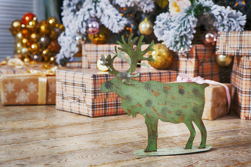 Card With Golden Festive Decoration.Green Moose, Christmas Ball, Hear, Star. Gray, Rustic, Vintage Wooden Background. Copy Space royalty free stock photos