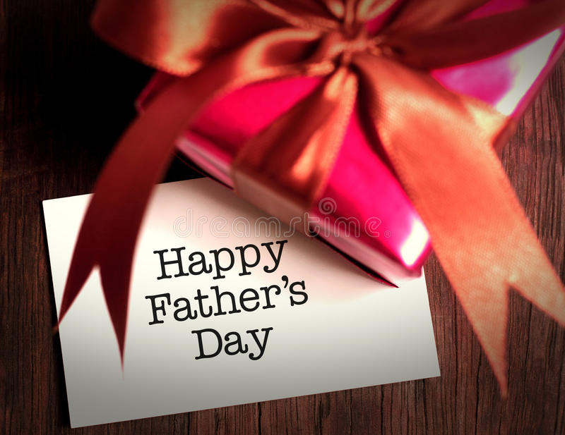 Card of happy fathers day and prensent box stock photos