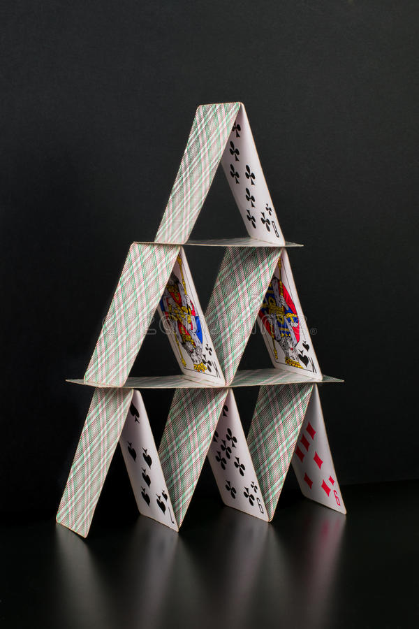 Card house. Photo symbolizing a house of cards that not everything is stable in this world stock photo