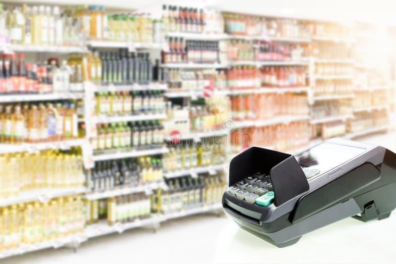 Card machine on blurred supermarket background. stock photo