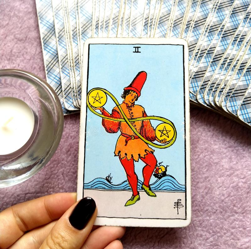 Two II of Pentacles Tarot Card Financial Decisions. This card is about Material Decisions, Financial Decisions, Juggling Finances, Cash-Flow, Balancing, Juggling stock photos