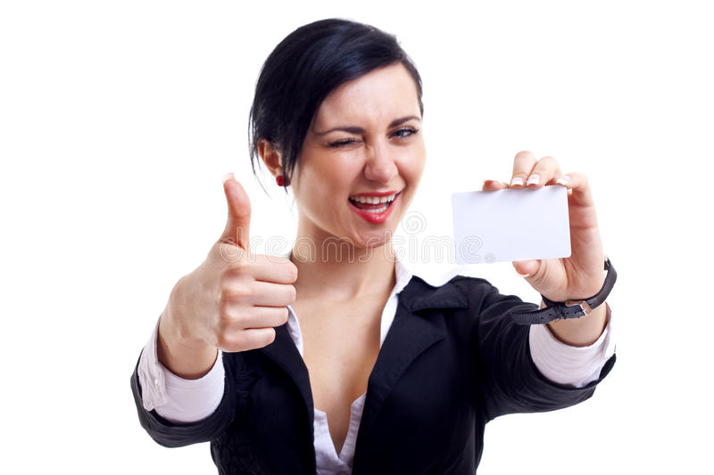This card is ok. Female holding blank business card, making ok sign and winking, focus on hands and card stock photos