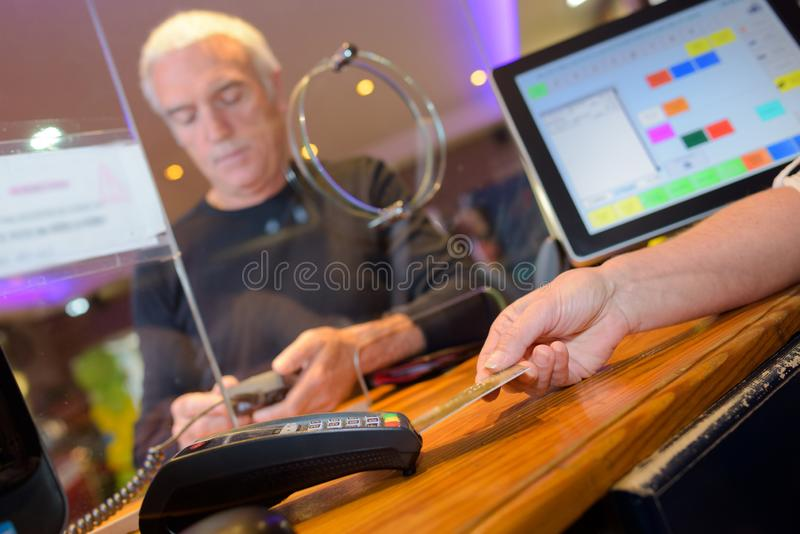 Card payment at ticket booth. Payment royalty free stock photos