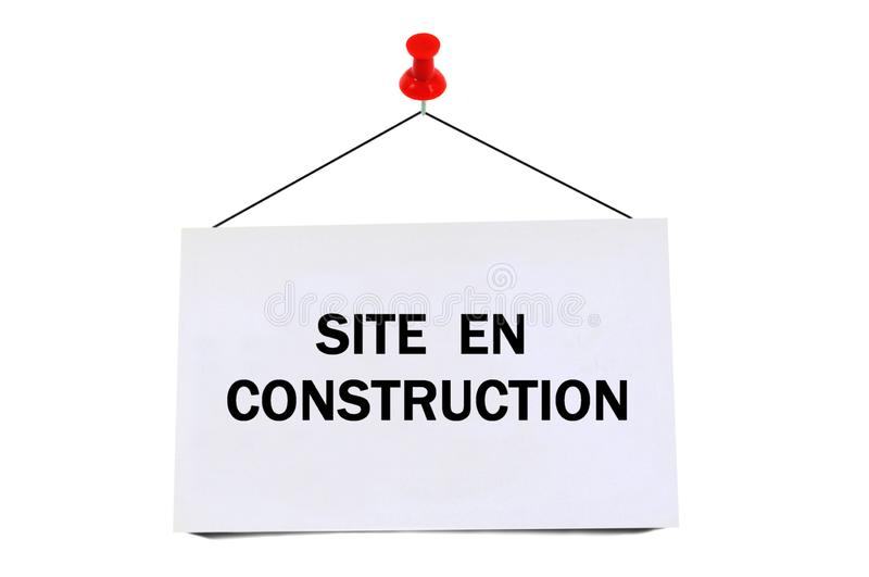 Card pinned on which is written site under construction. Close up on a pinned card on which is written in French site under construction on a white background royalty free illustration