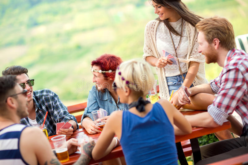Card players relaxed talk and having fun with alcohol beverage stock photography