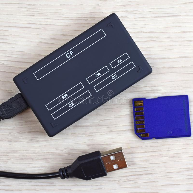 Card reader and flash drive. A device for transferring information from a flash drive to a computer royalty free stock photos
