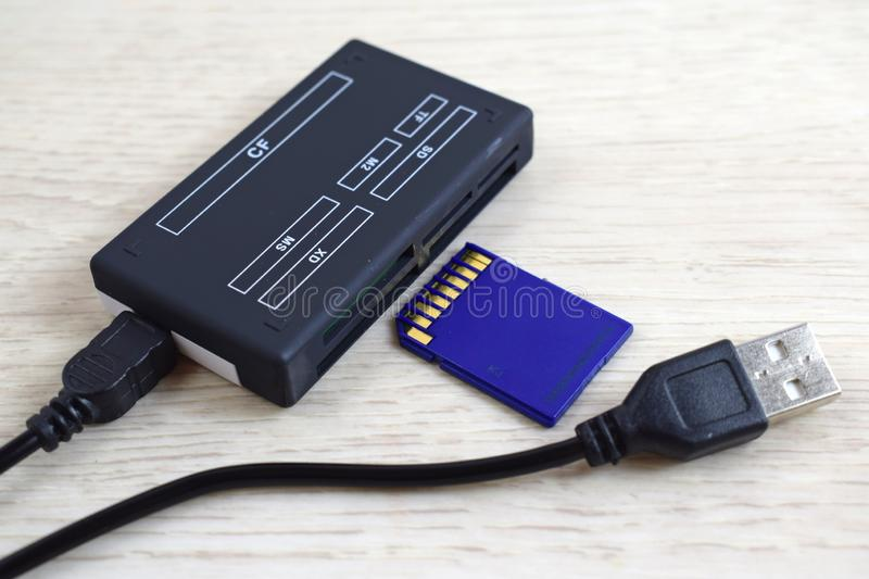 Card reader and flash drive. A device for transferring information from a flash drive to a computer stock images