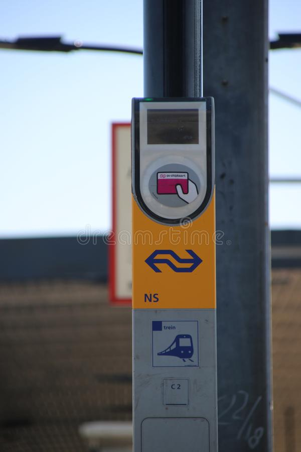Card reader payment terminak for OV Chipkaart, the dutch public transportation payment type at train station of Voorburg in the Ne stock image