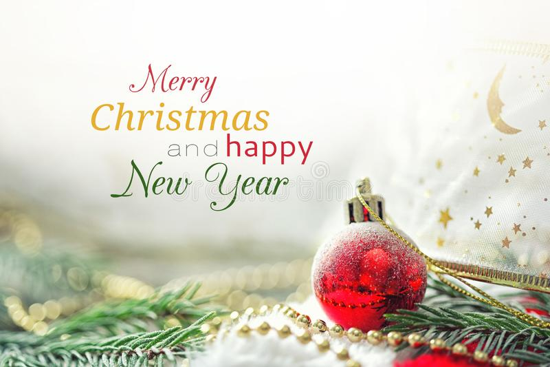 Card with red christmas ball and text Merry Christmas and happy New Year. holiday background stock photography