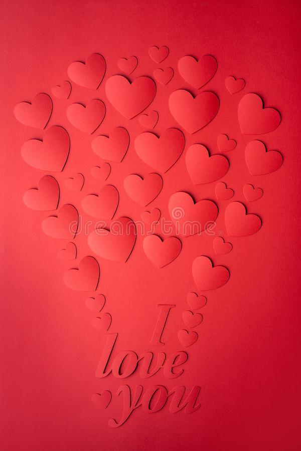 Card of red hearts, cut out of paper, laid out in the form of a balloon. royalty free stock photography