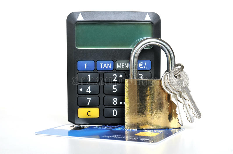 Card security with TAN Generator. Black TAN Generator and gold colored padlock with keys on top of a expired credit card royalty free stock image