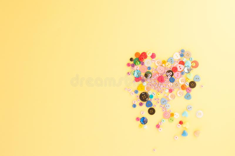 Card to the Valentine`s Day. A crumbling heart of buttons, beads stock photography
