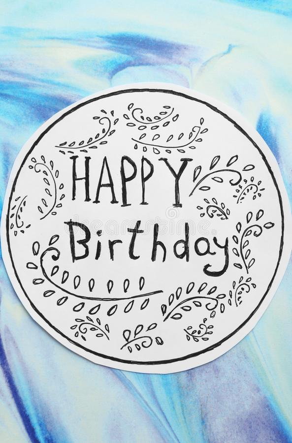 Card with words HAPPY BIRTHDAY and floral pattern on color background royalty free stock images