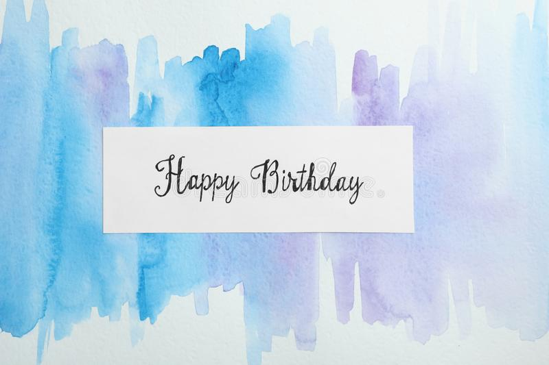 Card with words HAPPY BIRTHDAY on watercolor painting stock photography
