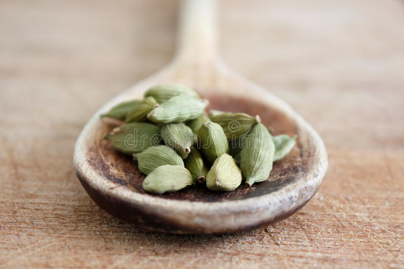 Cardamom. On a wooden spoon stock image