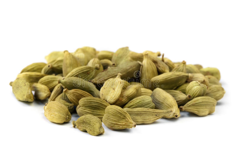 Cardamom. Heap of cardamom seeds, isolated on white stock image