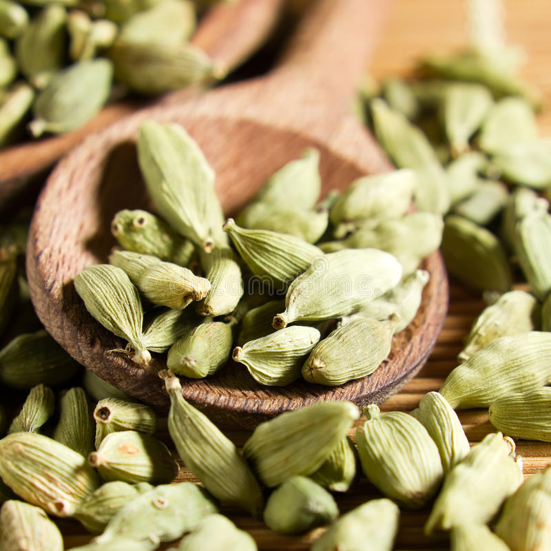 Cardamom. Fragrant cardamom seeds on the kitchen table royalty free stock photo