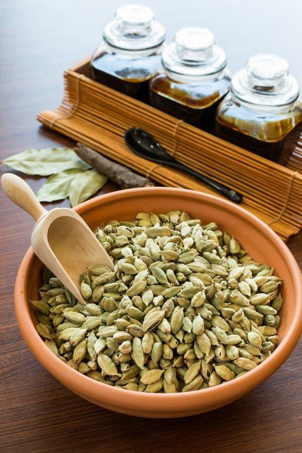 Cardamom in bowl stock photos
