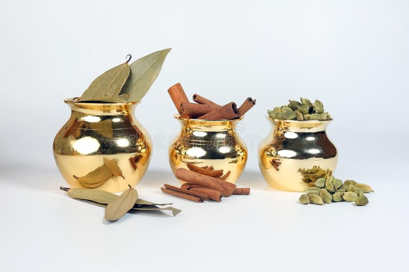 Cardamom cinnamon bay leaf spice in shiny metal pot royalty free stock images