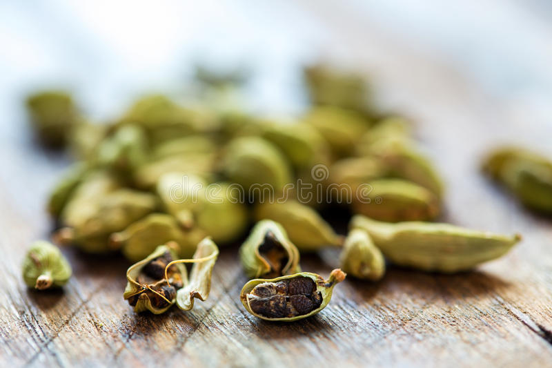 Cardamom closeup. Green cardamom grains on an old table close-up royalty free stock image