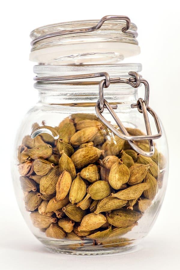 Cardamom pods in jar stock photos