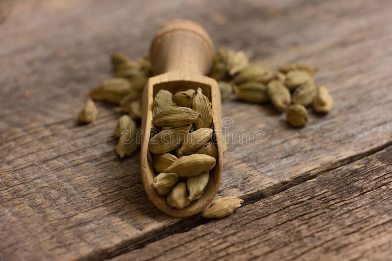 Cardamom pods. On a wooden background royalty free stock image