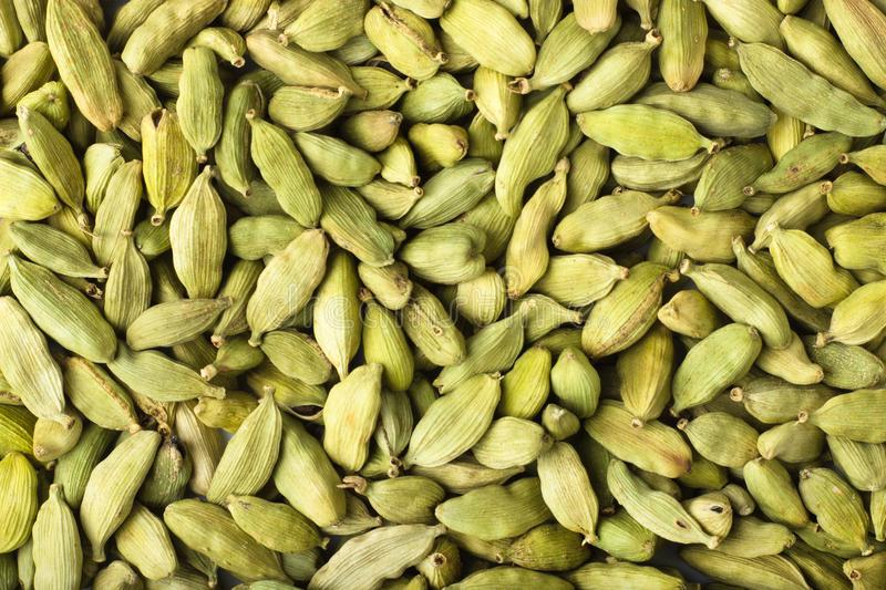 Cardamom seeds spice as a background, natural seasoning texture stock photo